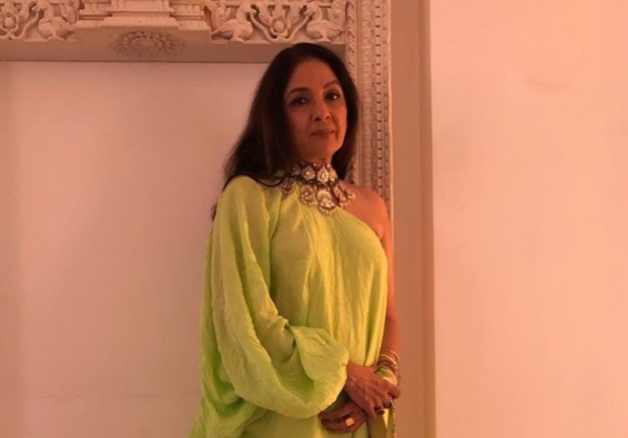 Neena Gupta sports sneakers with neon green outfit