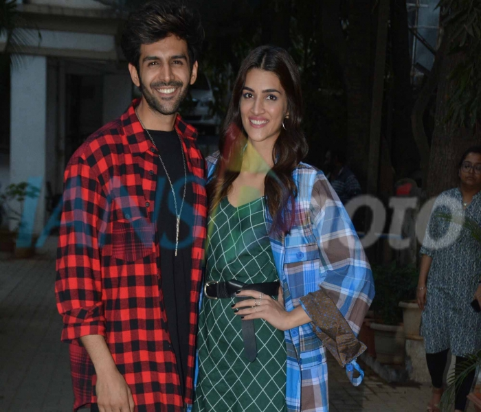 Actors Kriti Sanon and Kartik Aaryan during a programme organised to to promote their upcoming film