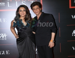 Mumbai: Actor Shah Rukh Khan with his wife Gauri Khan during the red carpet of