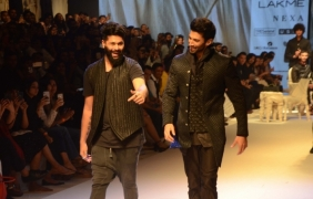 Aditya Roy Kapur and Arjun Kapoor walk the ramp for Kunal Rawal