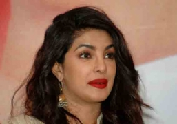 Priyanka trips, clasps Nick's arm, avoids fall