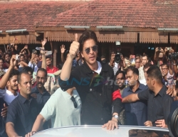 Mumbai: Actor Shah Rukh Khan greets fans Bandra railway station where he released a special postal cover on the eve of completion of 130 years of the heritage station, in Mumbai on Aug 23, 2019. (Photo: IANS)